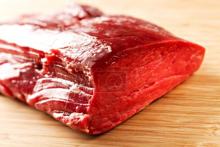 Photo for Raw Beef Tenderloin on wooden table - Royalty Free Image