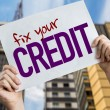 Fix Your Credit placard with cityscape background...