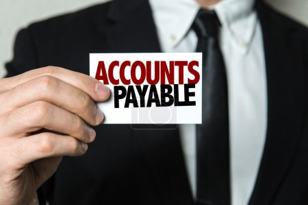 Photo for Businessman holding card with text:  Accounts Payable - Royalty Free Image