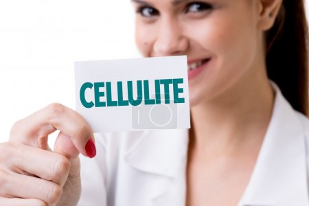 Photo for Smiling woman holding signboard with text cellulite - Royalty Free Image