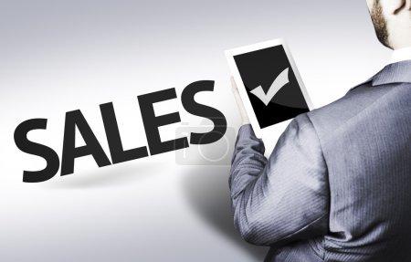 Photo pour Homme d'affaires avec le texte Ventes dans une image concept - image libre de droit