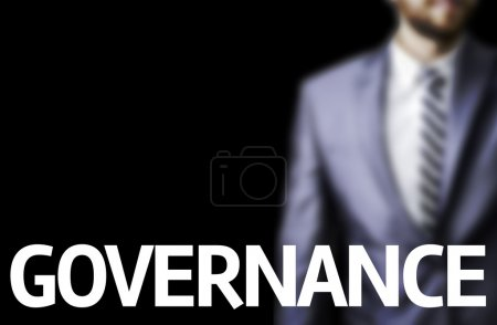 Governance written on a board with a business man