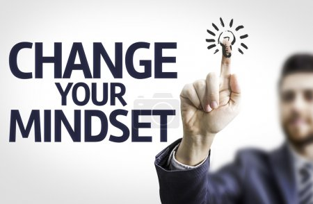 Photo for Business man pointing to transparent board with text: Change Your Mindset - Royalty Free Image