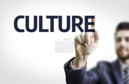 Photo for Business man pointing to transparent board with text: Culture - Royalty Free Image