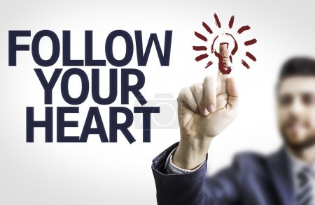 Board with text: Follow your Heart