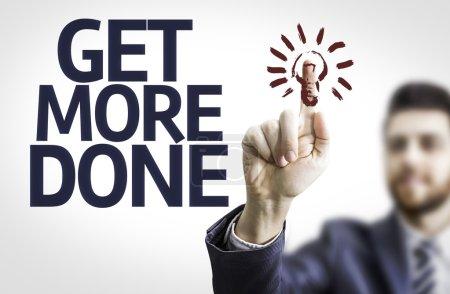 Photo pour Homme d'affaires pointant vers un tableau transparent avec du texte : Get More Done sur fond blanc - image libre de droit