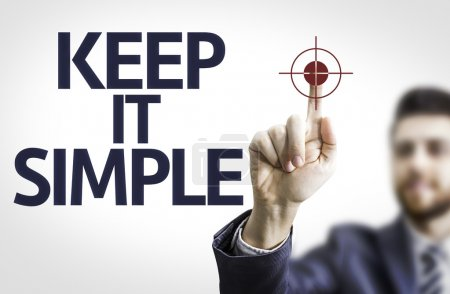 Photo for Business man pointing to transparent board with text: Keep It Simple - Royalty Free Image