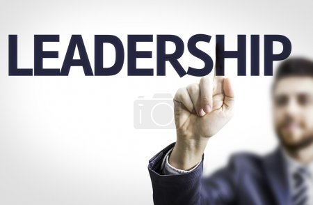 Business man pointing the text: Leadership