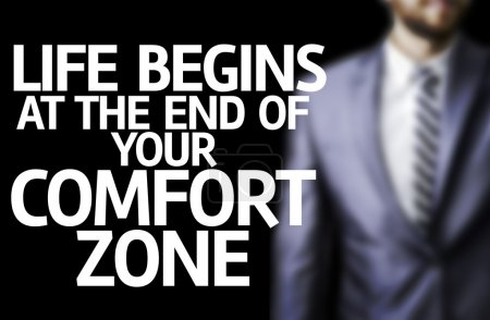 Life Begins at the end of Your Comfort Zone written on a board