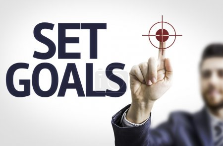 Business man pointing the text: Set Goals