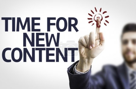 Photo pour Business man pointing to transparent board with text: Time For New Content - image libre de droit