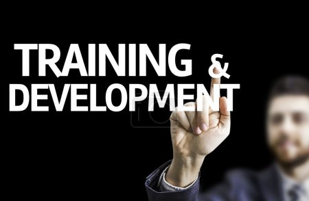 Business man pointing the text: Training & Development