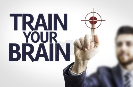 Business man pointing the text: Train your Brain