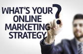 Business man pointing the text: What's your Online Marketing Strategy?
