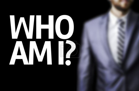 Photo for Who Am I? written on a board with a business man on background - Royalty Free Image