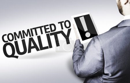 Business man with the text Committed to Quality in a concept image
