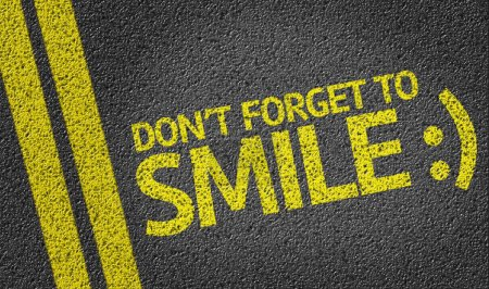 Don't Forget to Smile written on road