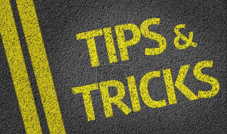 Photo for Tips & Tricks written on the road background - Royalty Free Image