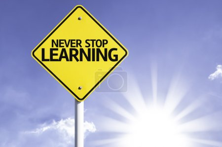 Photo for Never Stop Learning  road sign with sun background - Royalty Free Image