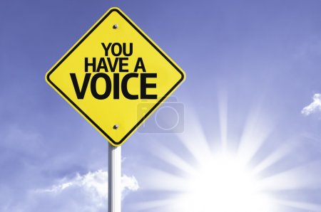 Photo pour You have  a Voice  road sign with sun background - image libre de droit