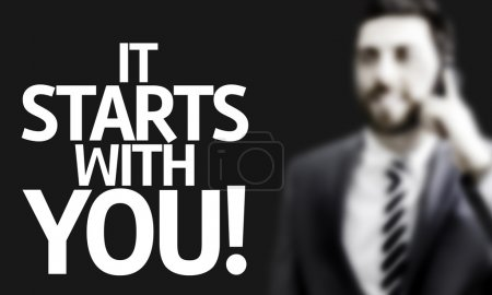 Business man with the text It Starts With You! in a concept image