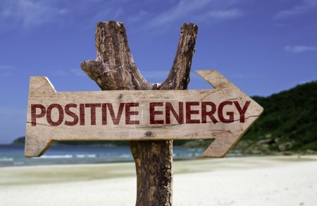 Photo for Positive Energy wooden sign with a beach on background - Royalty Free Image