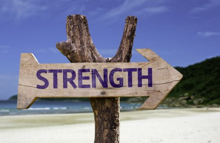 Strength wooden sign with a beach on background