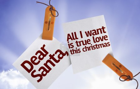 Photo pour Dear Santa, All I Want is True Love This Christmas on Paper Note on sky background - image libre de droit