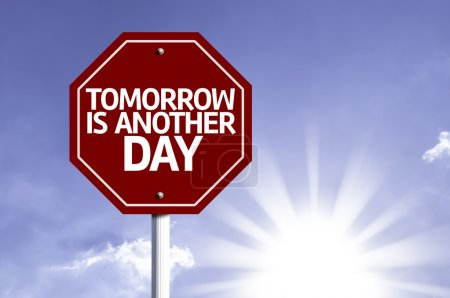 Tomorrow is Another Day written on red road sign