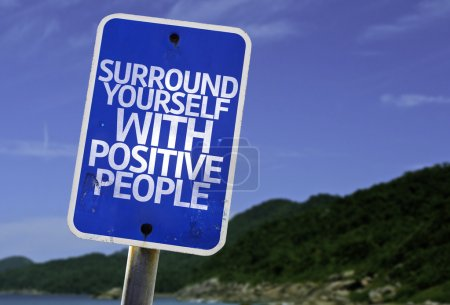 Photo for Surround Yourself with Positive People sign with a beach on background - Royalty Free Image