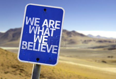 Photo for We Are What We Believe sign with a desert background - Royalty Free Image