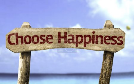 Foto de Choose Happiness sign with a beach on background - Imagen libre de derechos