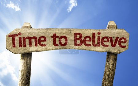 Photo for Time to Believe wooden sign on a beautiful day - Royalty Free Image