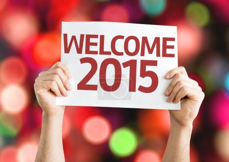 Welcome 2015 card with colorful background with defocused lights
