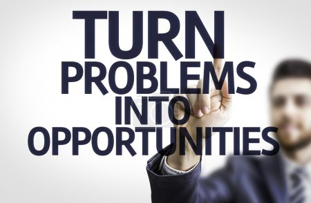 Photo for Business man pointing to transparent board with text: Turn Problems into Opportunities - Royalty Free Image