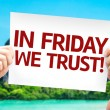 In Friday We Trust card  In hands with a beach bac...