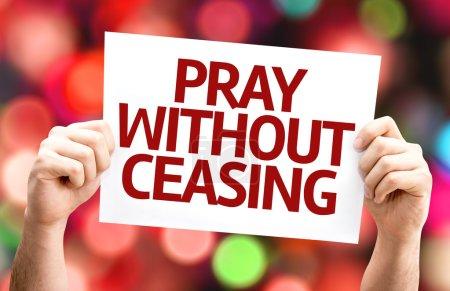 Photo pour Carte de prier sans cesse avec un fond coloré avec des lumières défocalisés - image libre de droit