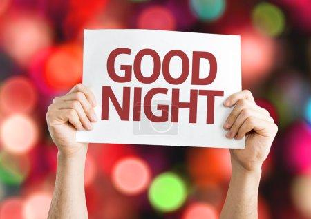 Photo pour Bonne carte de nuit avec fond coloré avec des lumières déconcentrées - image libre de droit