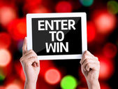 Tablet pc with text Enter to Win