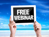 Tablet pc with text Free Webinar