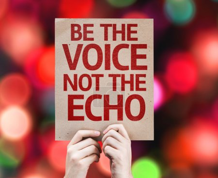 Photo for Be the Voice not the Echo card with colorful background with defocused lights - Royalty Free Image