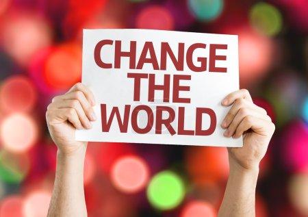 Photo pour Changer la carte du monde avec un fond coloré avec des lumières défocalisés - image libre de droit