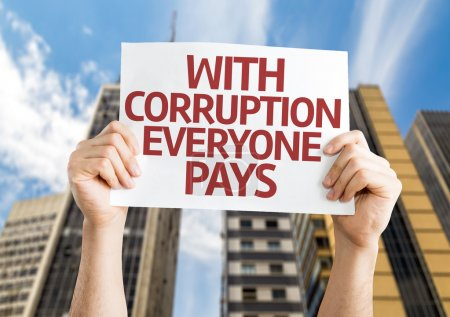 Photo for With Corruption Everyone Pays card with an urban background - Royalty Free Image