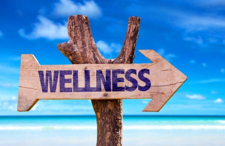 Photo for Wellness wooden sign with beach background - Royalty Free Image