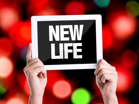 Photo pour Tablet pc avec texte nouvelle vie avec fond bokeh - image libre de droit