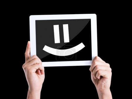 Photo for Tablet pc with text Smiley Face isolated on black background - Royalty Free Image