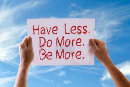 Photo for Have Less. Do More. Be More. card with sky background - Royalty Free Image