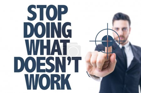 Photo for Business man pointing the text: Stop Doing What Doesn't Work - Royalty Free Image