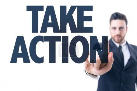 Photo for Business man pointing the text: Take Action - Royalty Free Image