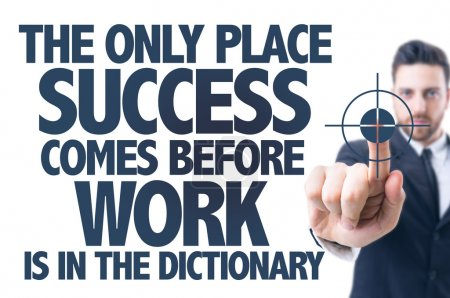 Photo pour Business man pointing the text: The Only Place Success Comes Before Work is in the Dictionary - image libre de droit